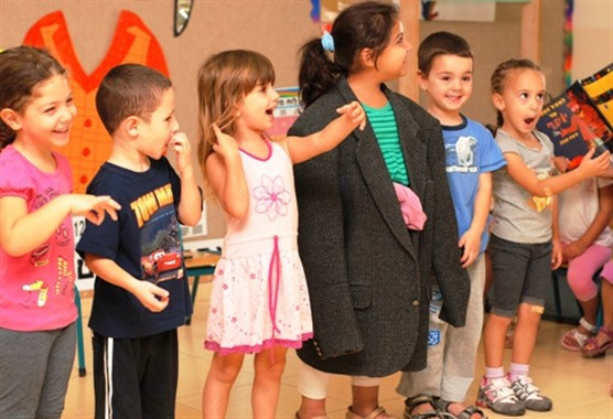 Children in Gan Chatzav in Migdal Ha'Emek acting out Joseph Had a Little Overcoat