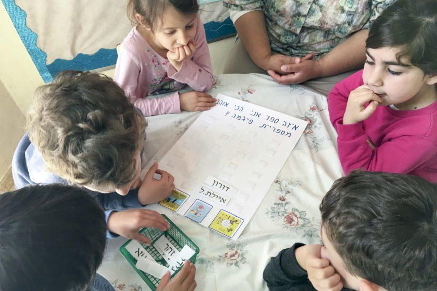 Choosing their favorite Sifriyat Pijama book in a Gan in Shoham